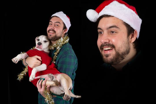 Andrew Atkins with his dog, Kisses, photographed on Friday, December 20, 2019.