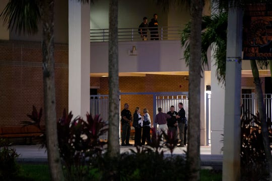 Collier County Sheriff's Office deputies and school officials stand by the entrance as students arrive for class in the morning at Lely High School in East Naples on Friday, December 20, 2019. An adult education student was shot and killed on the school grounds on Thursday night.