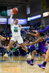 Tytionia Adderly of the Florida Gulf Coast University shoots the ball during the game against Louisiana State University on Thursday, December 19, 2019, at Alico Arena in Estero.
