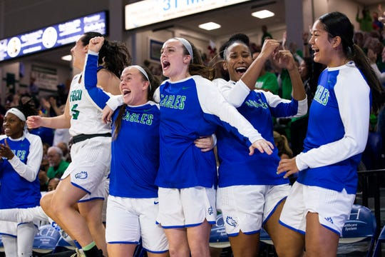 The Florida Gulf Coast University women basketball team celebrates the scoring of a goal during their game against Louisiana State University on Thursday, December 19, 2019, at Alico Arena in Estero.