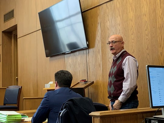 Larry Madden, right, turns to address the family of Michael Hayden, who was killed in a fiery crash on Ohio 37 in February 2018. Madden pleaded guilty Friday to misdemeanor charges of vehicular homicide and falsification in connection to the crash.