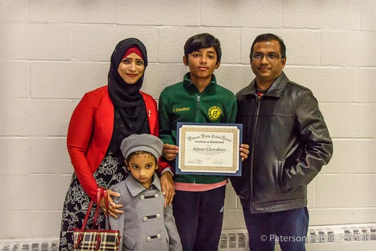 Salman Chowdhury (in green) with his mother, Fathema Chowdhury, and father, Mohammed Chowdhury, along with his younger sister.