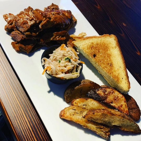 American foods like grilled cheese and brisket are served at The Yard.