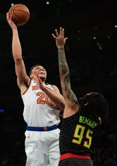 Kevin Knox II #20 of the New York Knicks takes a shot past DeAndre' Bembry #95 of the Atlanta Hawks during the second half of their game at Madison Square Garden on Dec. 17, 2019 in New York City.