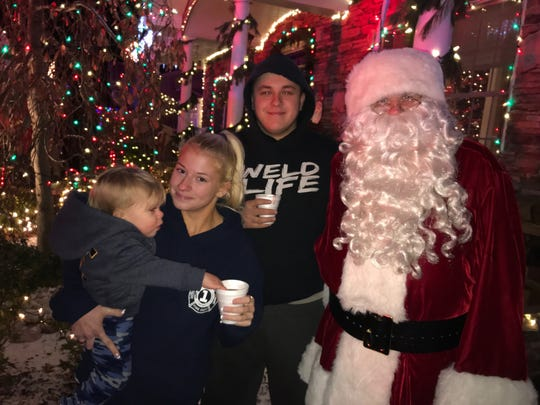 Firefighter Kyle Wilson and family with Santa Boone on Thursday, Dec. 19, 2019 in Fair Lawn.