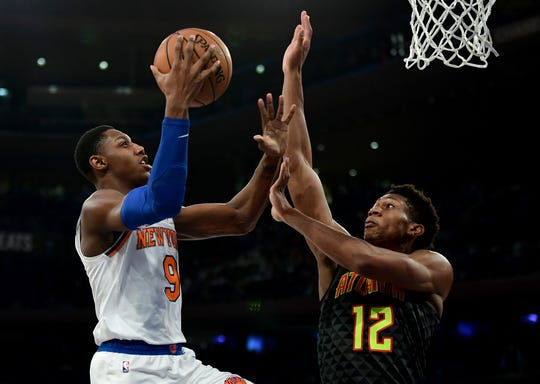 RJ Barrett #9 of the New York Knicks drives toward the basket past De'Andre Hunter #12 of the Atlanta Hawks during the second half of their game at Madison Square Garden on Dec. 17, 2019 in New York City.