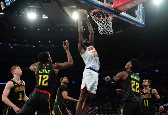 Mitchell Robinson #23 of the New York Knicks dunks the ball during the second half of their game against the Atlanta Hawks at Madison Square Garden on Dec. 17, 2019 in New York City.