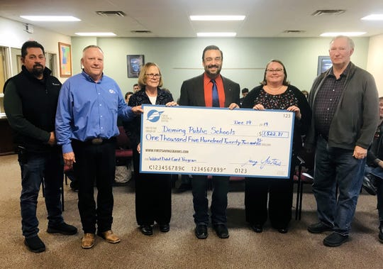 First Savings Bank handed over a check in the amount of $1,522.81 to the Deming Public Schools Board of Education on Thursday during the regular board meeting at the Emmett Shockley Administration Building, 400 Cody Road. The money came from a percentage of transactions from the bank's Wildcat Debit Card promotion. This was the second year of the promotion. During the inaugural year in 2018, the bank turned over a check for $500. The Deming branch led the southern half of the state in the amount donated.Pictured, from left, are Billy Ruiz, board member, Jay Yates, bank market president; Tris McSherry, superintendent Arsenio Romero, Amy DeLaney, board member; and William Anderson, board president.
