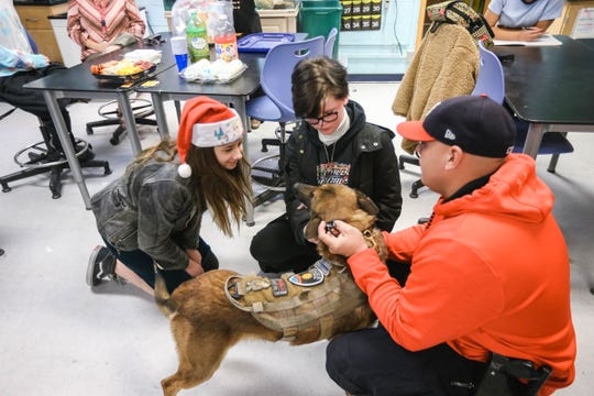 Las Cruces Police Officer Juan Gomez and Joker, his K9, attend a meeting of the Vet Tech Club at Lynn Middle School in Las Cruces on Thursday, Dec. 19, 2019.