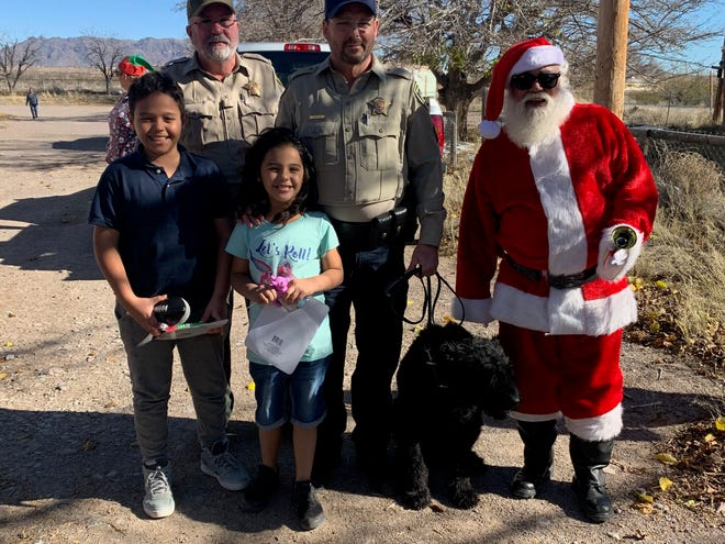 Sgt. Gerry Madden, retired from the Doña Ana County Sheriff's Office, played Santa Claus to kids in some of the county's most rural communities.