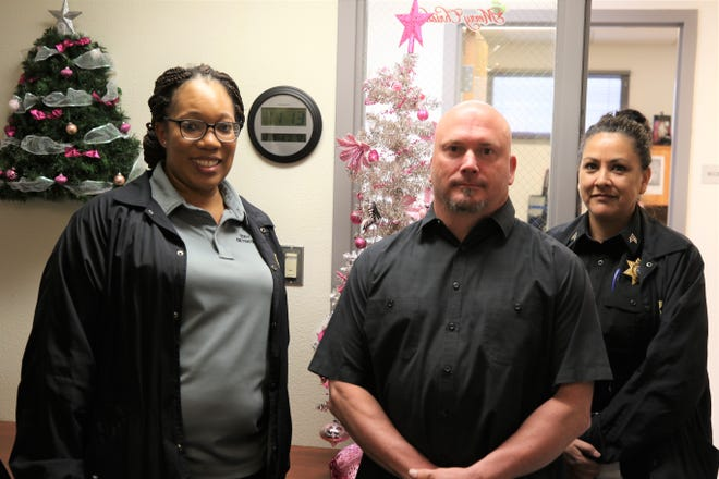 From left:Lannette Ruiz, Billy Massingill and Sgt. Felicia Voldahl get ready for Christmas at the Eddy County Detention Center.