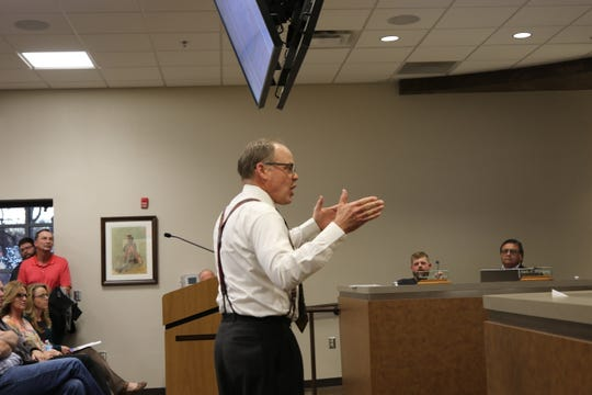 Alan Wood speaks in opposition to a proposed townhouse development before the Carlsbad City Council Dec. 19.