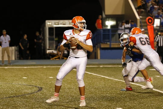 Artesia's Clay Houghtaling looks to pass against Carlsbad in the 2019 Eddy County War. Houghtaling finished the season with the second-most single-season touchdown passes in school history (46).