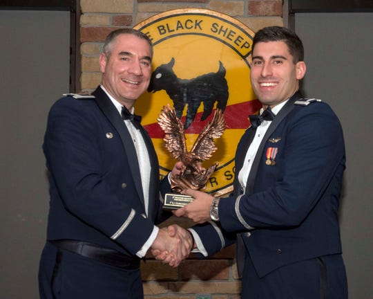1st Lt Domenick Stumpo, 8th Fighter Squadron Basic Course graduate, accepts the Distinguished Graduate award during the graduation of B-Course Class 19-CBF, Dec. 14, 2019, on Holloman Air Force Base, N.M. 11 B-Course students graduated and will be reassigned to operational flying units throughout the combat Air Force.
