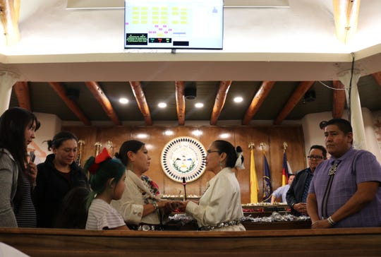 Chief Justice JoAnn Jayne, right, administers the oath of office to Neomi Gilmore on Dec. 19 at the Navajo Nation Council Chamber in Window Rock, Arizona.