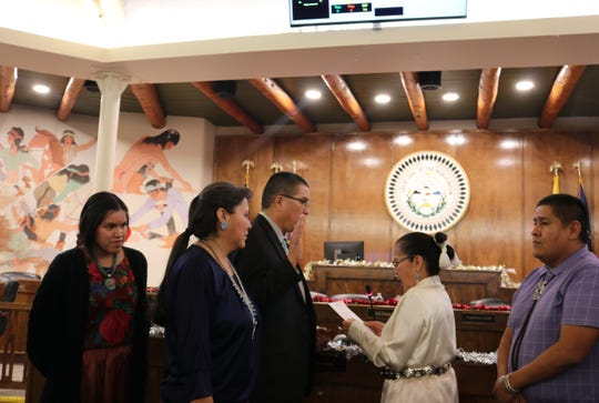 Malcolm Laughing is sworn in as a district court judge for the Navajo Nation on Dec. 19. Chief Justice JoAnn Jayne administered the oath of office at the Navajo Nation Council Chamber in Window Rock, Arizona.