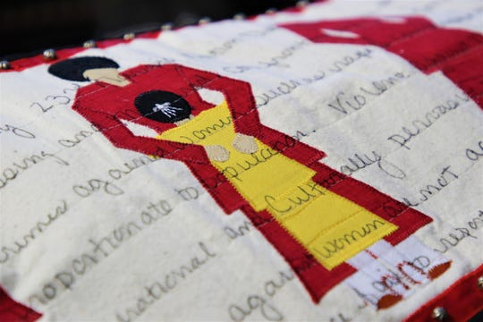 A close-up of a quilted dress tackling the issue of missing and murdered indigenous women by Navajo quilt artist Susan Hudson displays a quilt she's currently working on at her studio in Ignacio, Colorado on Dec. 18, 2019.