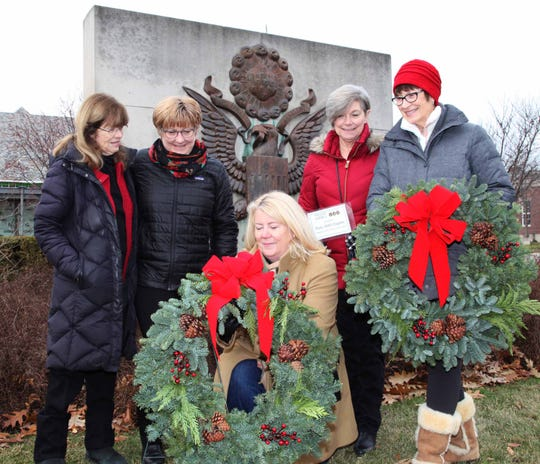 Laying wreaths by the Piety Hill Chapter of the DAR (from left) Janet Ashley (Bloomfield Hills), Debbie Harrington, 2nd Vice Regent, (Birmingham); Lisa Milton, Regent, (Bloomfield Hills); Holly Heiss 1st Vice Regent, (Birmingham); and Marcia Vetrone, (Troy).