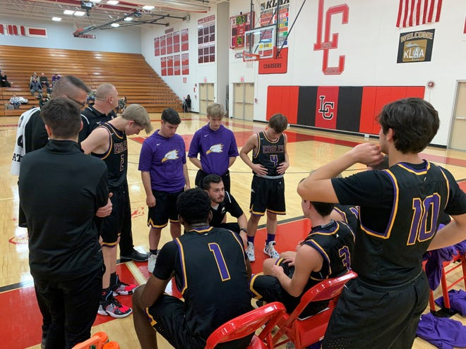 Plymouth Christian Academy coach Matt Windle talks to his team during a timeout against Livonia Churchill.