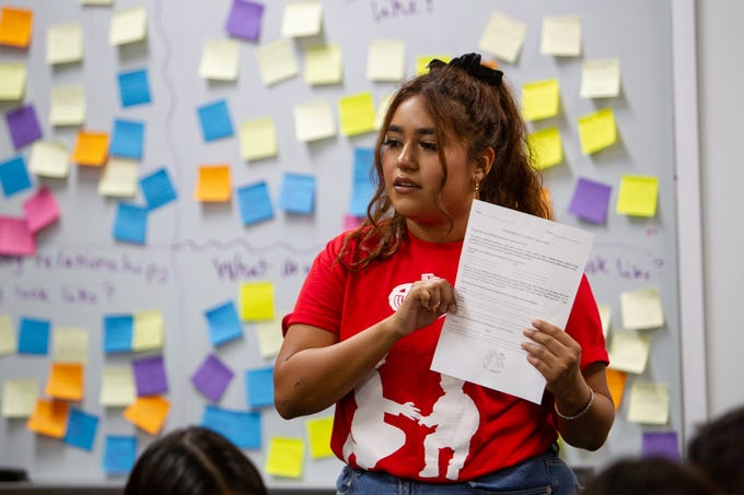 Analyssa Flores, a program specialist at Aguila Youth Leadership Institute, talks to eighth-graders about the differences between jobs and careers, Dec. 11, 2019.