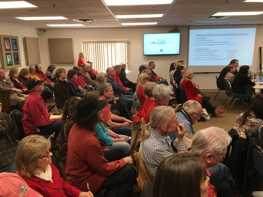 People listen while the Yavapai County Planning and Zoning Commission discusses a proposed rezoning for a development called Spring Creek Ranch on Dec. 19. Opponents of the rezoning wore red and filled the meeting room, as well as an overflow room.