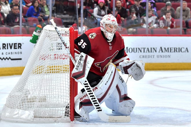 Dec 19, 2019; Glendale, AZ, USA; Arizona Coyotes goaltender Darcy Kuemper (35) defends the goal against the Minnesota Wild during the first period at Gila River Arena earlier this season.