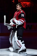Dec 19, 2019; Glendale, AZ, USA;  Arizona Coyotes goaltender Darcy Kuemper (35) looks on during the National Anthem prior to a game against the Minnesota Wild at Gila River Arena. Mandatory Credit: Matt Kartozian-USA TODAY Sports