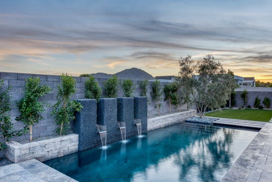 The $2.54M estate, sold by Shea Homes Arizona Limited Partnership, resort-style pool with waterfall accents.