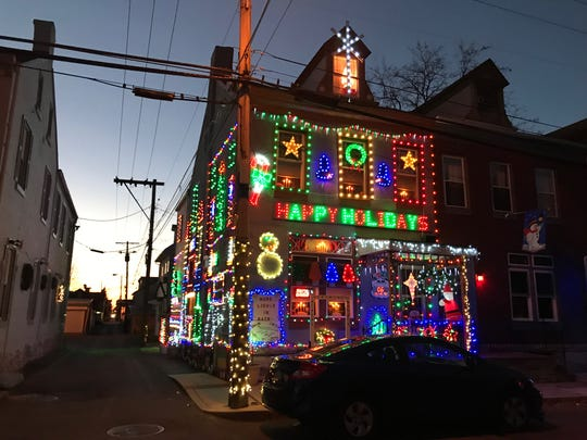 The entire front and side of the Willemans house on 4th Street light up every evening during the Christmas season. People come from all over the city to look at the lights.