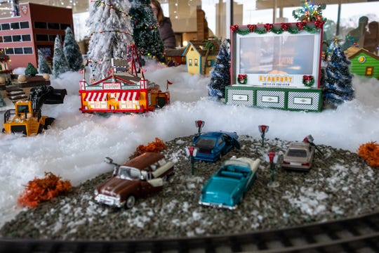 Toy cars are lined up at a drive-in theater as part of the Christmas train display at McLaren Port Huron.