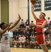 Red Hook's Dylan Bayliss takes a jump shot over Spackenkill's Jaylen Rouse during Thursday's game on December 19, 2019.