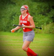 Red Hook's Danielle Walsh retrieves the ball after a goal during an Oct. 2018 game.