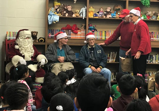 Doug and Louise Brown started Wood to Wonderful in 1987. With the help of a core group of nine volunteers who have a range of disabilities, the organization builds 6,000-7,000 toys each year. Carl Bard and his 94-year-old father - both Chambersburg natives - helped distribute the toys. Carl now lives in Reading and is a volunteer at Wood to Wonderful.
