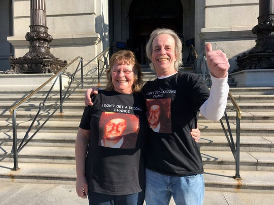Joe Zink gives a thumbs up after he and sister Deb Zink Whetzel spoke on Dec. 20, 2019, at the state pardon hearing of Robert Altland, who murdered their brother, John Zink, in York County in 1979. Altland was denied clemency.  (Liz Evans Scolforo photo)