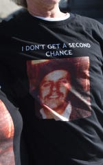 Joe Zink wears a T-shirt with a photo of his late brother, John, on it.  He was shot and killed in Hellam Township on March 9, 1979.