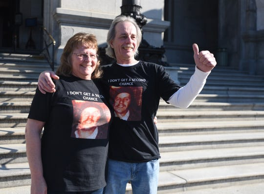 Deb Zink Whetzel, left, and her brother, Joe Zink, right, smile outside the Pennsylvania State Capitol on Friday after the state Board of Pardons voted against commuting the life sentence of Robert Altland. Altland, now 60, of Jefferson, shot and killed their brother, John Zink, near Codorus Furnance in Hellam Township on March 9, 1979.