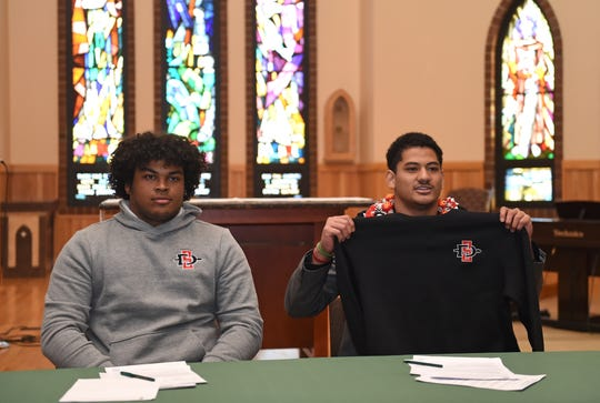 Bishop Manogue's  Vai Kaho, left, and Joey Wright signed to play football at San Diego State University during a signing ceremony at the Bishop Manogue Chapel on Wednesday Dec. 18, 2019.