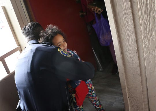 3 year old Lilly'Anna Middleton hugs RPD Officer Utter during the annual Reno Police Christmas Outreach on Dec. 20, 2019.