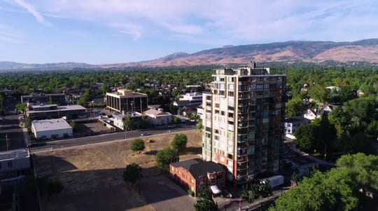 An aerial view of the project site for CAI Investment's planned 20-story luxury boutique hotel in downtown Reno.