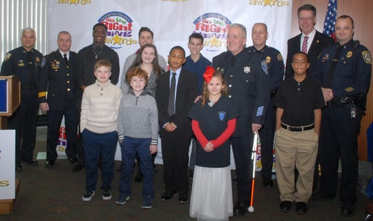 From left to right, Do the Right Thing December winners: Front Row:  Bailey Clark; second row:  Zachary Adanti, Liam Adanti, Dominic Brunet, RPD Officer Denny Wright, LaMonte Neal third row:  Irondequoit Police Chief Tantilo, Rochester Police Deputy Chief Mura, Nathan Carter, CJ Leonard Lauren Chapell, Stephen Passero, Brighton Police Chief David Catholdi, Brighton Bill Moehle, Gate Police Lt Rob Long (not pictured, Zechariah Harris-Scott).