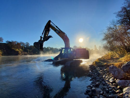 Yurok Tribe crew uses an excavator to build a channel at Anderson River Park as a safe haven for young fish.