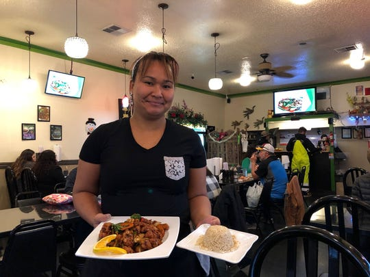 Server Wan Kanhasiri with a lunch order at Rose Garden.