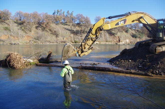 Aaron Martin, a habitat restoration biologist with the Yurok Tribe, oversees the construction of a new fish channel at Anderson River Park.