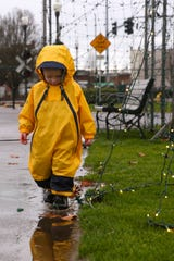 Wyatt Hale, 3, splashes in a mud puddle at Riverfront Park on Dec. 20, 2019. Bundled up in a rain jacket, Wyatt played despite an on-and-off drizzle.