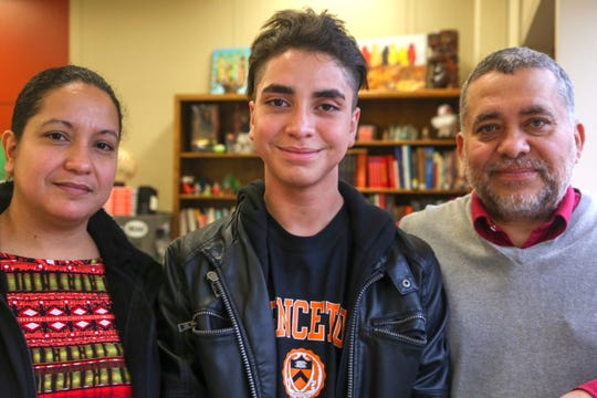 McKay High School student Joshua Arce Masis and his parents, Manuel Arce and Jocelyn Masis, at McKay High School in Salem on Dec. 19, 2019, just over a week after finding out he will attend Princeton University in 2020.