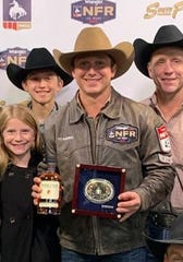 San Angelo's Ty Harris shows off his buckle won in Round 6 of the Wrangler National Finals Rodeo Dec. 10, 2019, in Las Vegas, Nevada.