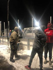 Brandon Valley Hockey Association volunteers put the glass on the boards of the reconstructed outdoor facility.