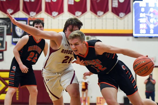 Nate Gilbertson of Washington pushes aroundBrandon Dannenbring of Roosevelt during their game on Thursday, Dec. 19, at Roosevelt High School in Sioux Falls.