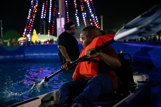 A Bahamian child enjoys the kayak pool at a special four-day event put on by Bass Pro Shops and Convoy of Hope.