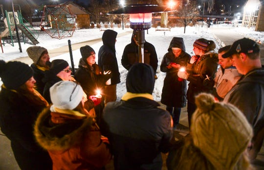 People gather after a candlelight vigil Thursday, Dec. 19. 2019, in St. Cloud for three guardsmen killed in a Dec. 5 helicopter crash.